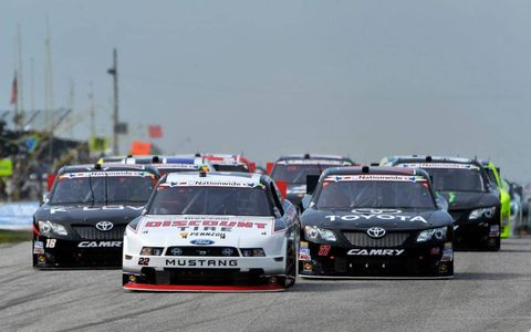 A.J. Allmendinger leads the field at the start of the NASCAR Nationwide Series race at Road America on Saturday.