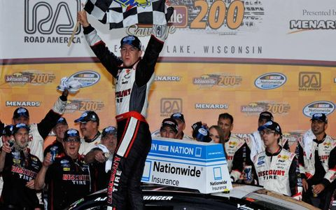 A.J. Allmendinger made his first visit to a NASCAR victory lane on Saturday.