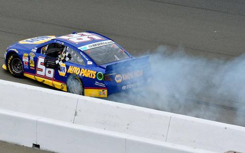 Martin Truex Jr. does his first burnout after a Sprint Cup Series win since 2007.