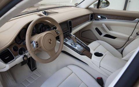 Motor vehicle, Steering part, Vehicle, Steering wheel, Vehicle door, Car seat, Center console, Personal luxury car, Car seat cover, Luxury vehicle,