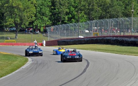 A Sports 2000 car keeps up with two Corvette roadsters.