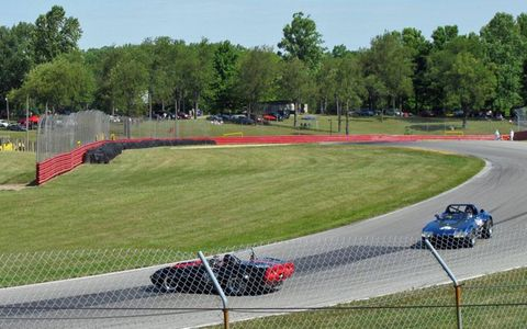 Serious racing: two Corvettes narrowly avert a collision as the leading car loses traction.