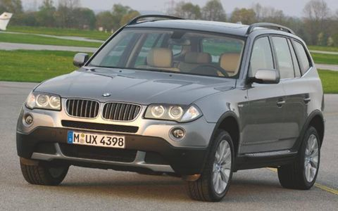 BMW is massaging its X3 ute for the '07 model year, applying subtle design updates in addition to ramping-up engine power. Design changes include: a larger kidney grille; a redesigned front bumper and spoiler; a color-keyed spoiler and front fog lights incorporated into the bodywork. At the rear are new light clusters, color-keyed panels extending lower down the bodywork and larger twin exhaust pipes. Inside, there's a new three-spoke steering wheel and other materials enhancements.