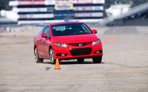 "Through our tight 490-foot slalom, one tester described the Si with the standard limited-slip differential and optional Michelin Pilot Sport Exalto performance tires to have ""flickable dynamics,"" and called it ""well-balanced,"" with precise steering, averaging 43.7 mph with traction control turned off."