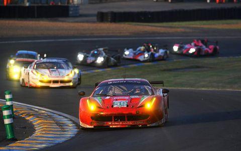 2012 24 Hour at Le Mans: Frederic Makowiecki/Jaime Melo/Dominik Farnbacher, Luxury Racing, No.59 Ferrari 458 Italia, leads Manuel Rodrigues/Philippe Illiano/Alain Ferte, JMB Racing, No.83 Ferrari 458 Italia, and a gaggle of other cars.