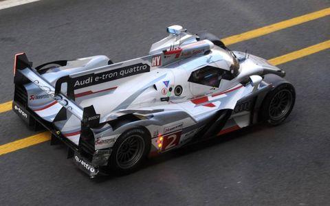 2012 24 Hour at Le Mans: Allan McNish/Rinaldo Capello/Tom Kristensen, Audi Sport Team Joest, No.2 Audi R18 E-Tron Quattro Hybrid, comes in to the pits with front bodywork damage.