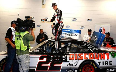 Rain moved Brad Keselowski's victory lane celebration indoors at Kentucky on Friday night.