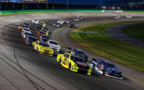 Matt Crafton (33) and Elliott Sadler (11) lead a pack.