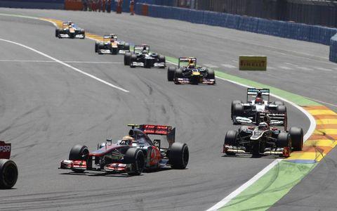 2012 European Grand Prix: Lewis Hamilton, McLaren MP4-27 Mercedes, leads Kimi Raikkonen, Lotus E20 Renault, Michael Schumacher, Mercedes F1 W03, and Mark Webber, Red Bull RB8 Renault.