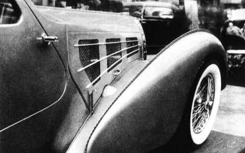 The front fenders were built from narrow strips of magnesium that were welded together and then cut in two longitudinally.