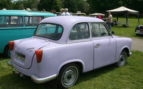 Look mama, a purple car! And just my size! We're not sure this was a factory color, but it's an authetnic 1963 Trabant (the S logo in the grille is for its all-but-forgotten East German manufacturer, Sachsenring). Yes, the hood is closed all the way. The trunk and the doors, too.