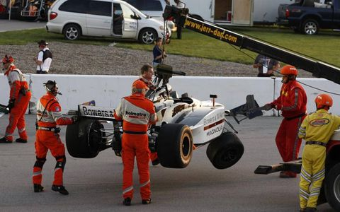 Alex Tagliani's car gets towed away after an incident during practice. Photo by: Dan Streck/LAT Photographic