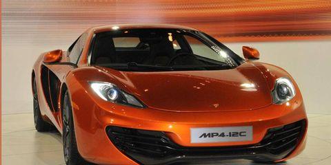 Motor vehicle, Mode of transport, Automotive design, Vehicle, Land vehicle, Automotive lighting, Transport, Headlamp, Car, Orange,