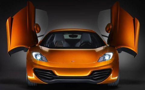 Mode of transport, Automotive design, Yellow, Land vehicle, Automotive lighting, Orange, Headlamp, Car, Automotive mirror, Performance car,