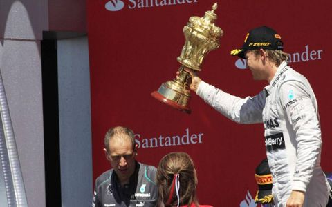 Nico Rosberg hoist trophy after winning at Silverstone.