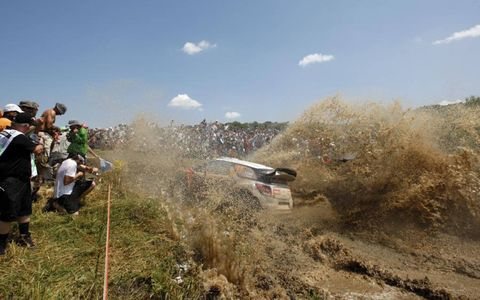 """Mud Bath//Petter Solberg pilots his Citroën WRC through a mud hole during a stage at the Acropolis Rally, also known as the """"Rally of the Gods."""" Solberg won the first four stages of the event, eventually finishing fourth in the rally won by Sébastien Ogier."""