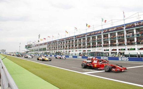 Kimi Raikkonen, Ferrari F2008, 2nd position, leads the field away for the warm up lap