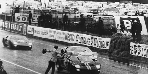 three ford gt40 mk iis crossing the finish line at the 24 hours of le mans ford swept the podium finishing first, second and third in its 1966 appearance at the famous endurance race the no 2 car piloted by chris amon and bruce mclaren took the checkered flag