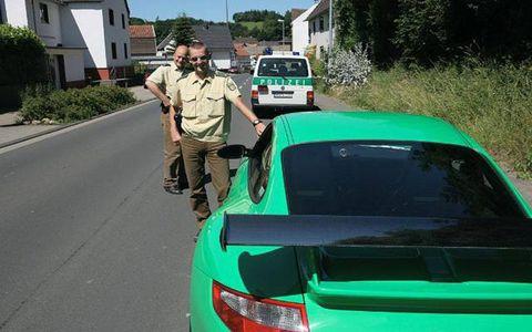 German police take a moment to inspect Ronan McGrath's Porsche.