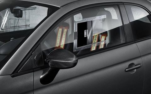 Even the glass side windows have been replaced to save weight.