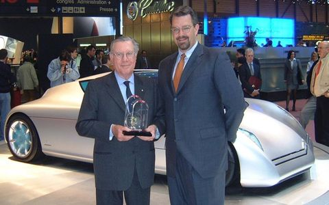 Sergio Pininfarina, left, accepts an Autoweek Editors' Choice Best Concept award from editorial director Dutch Mandel at the 2001 Geneva motor show for the Citroën Osse, shown in the background.
