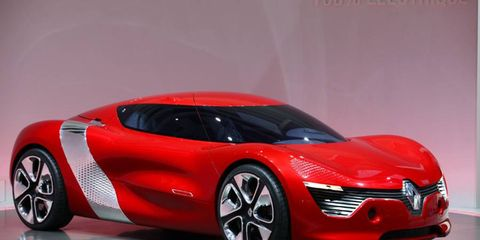 Tire, Mode of transport, Automotive design, Automotive mirror, Vehicle, Transport, Car, Concept car, Red, Automotive exterior,