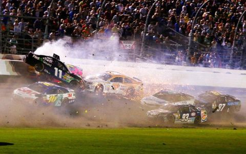 Denny Hamlin (11) gets a wild ride, courtesy of A.J. Allmendinger at Daytona on Saturday night.