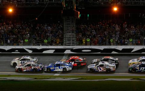 Jimmie Johnson (48) takes control on the final restart.