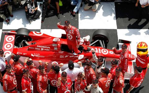 Scott Dixon and his crew begin the celebration in victory lane at Pocono on Sunday.
