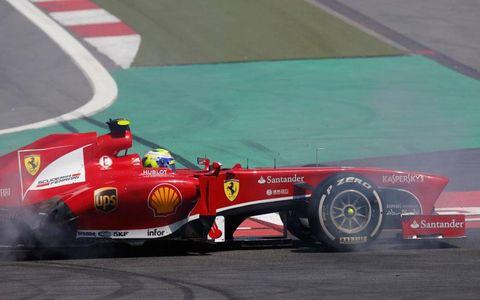 Ferrari hopeful Felipe Massa went out early in Germany.