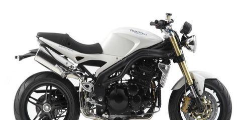 Motorcycle, Motor vehicle, Wheel, Fuel tank, Automotive tire, Automotive design, Automotive lighting, Rim, Transport, Spoke,