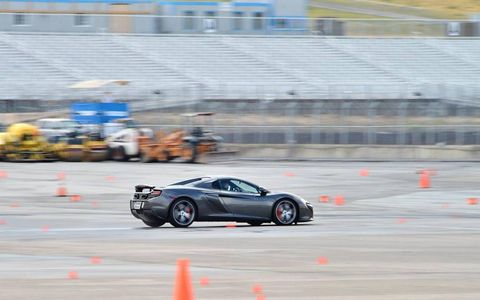 More autocross action in the paddock. Delightful car at low or high speeds.