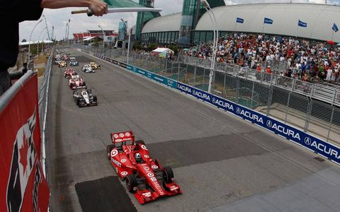 Dario Franchitti takes the green flag at the start of Sunday's IndyCar race in Toronto.