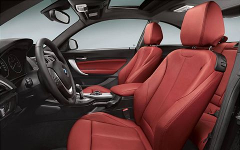 The 2014 BMW M235i Coupe produces 320 hp with 330 lb-ft of torque.