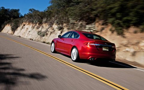 Tire, Mode of transport, Automotive design, Road, Car, Rim, Alloy wheel, Mid-size car, Personal luxury car, Asphalt,