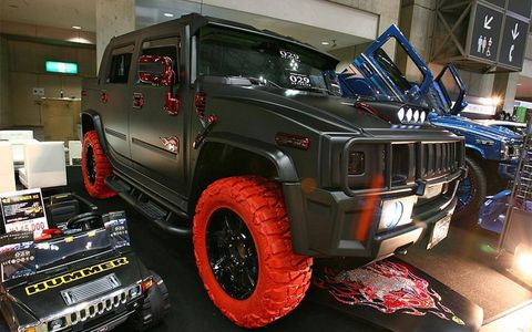 This H2 was fitted with some curious red Nitto tires that complemented the red body accessories.