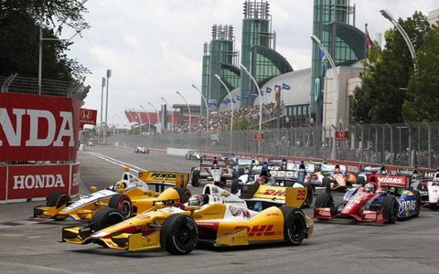 2012 IndyCar at Toronto: Ryan Hunter-Reay and Helio Castroneves battle ahead of the field at the start.