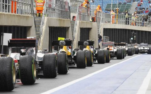 2012 British Grand Prix: The drivers queue to get back on to the circuit.