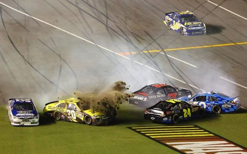 BULLDOZER // Joey Lagano's Toyota Camry doubled as an earth-mover in a crash during the NASCAR race at Daytona. Lagano was not injured in the crash.