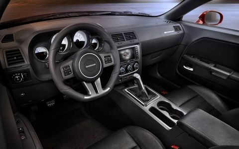 The 2014 Dodge Challenger R/T Plus 100th Anniversary Edition is equipped with a 5.7-liter V8.