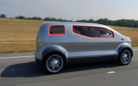 The entire right-hand side of the vehicle consists of a large gull-wing door and a slide-out step.