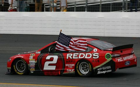 Brad Keselowski starts the celebration in New Hampshire with a victory lap.