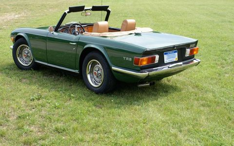 Correct matte-black tail panel and early-style outline TR6 script are both correct for this car.