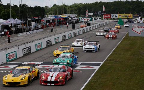 The GT classes cross the start/finish line at the start of the race on Sunday.