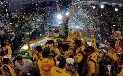 Kyle Busch and his NASCAR Sprint Cup team celebrate their victory at Kentucky Speedway on July 9. Photo by: Jared C. Tilton/Getty Images