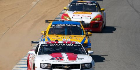 A train of GT cars races around Laguna Seca in Monterey, Calif. during practice on July 8. Photo by: R.D. Ethan/LAT Photographic