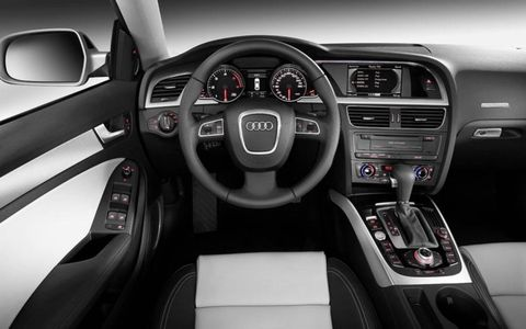 Motor vehicle, Steering part, Mode of transport, Automotive design, Product, Steering wheel, Center console, Transport, Speedometer, White,