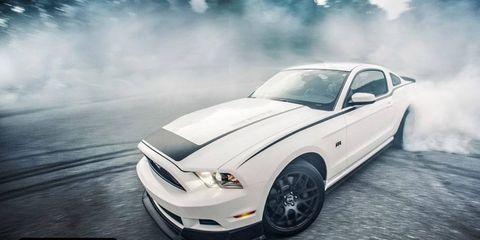 The 2013 Ford Mustang RTR kicks up some smoke.