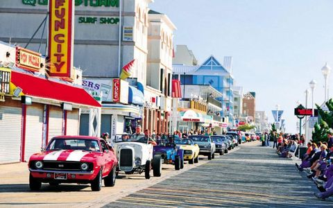 Cars drive down the boardwalk in Ocean City, MD., one of the largest mid-Atlantic seaside resorts.