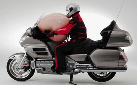 Honda's Goldwing is a large and heavy touring bike that now offers airbags to protect the rider in case of a crash. Price: $24,349